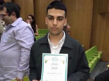 آمن زعبي (16 عامًا)يحصل على جائزة تقدير عالية
