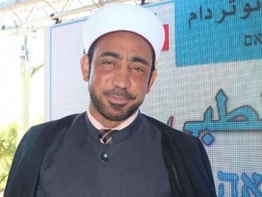 توقيع الشيخ سمير عاصي على بطاقة التبرع بالأعضاء