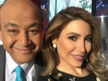 يارا بإطلالة جميلة الى جانب الإعلامي عمرو أديب