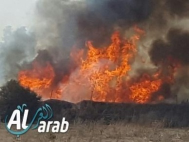 اندلاع حريق بمساحات مفتوحة في جسر الزرقاء