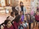 عكا: توزيع كسوة العيد والطرود الغذائية على العائلات