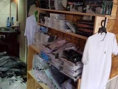 كفرمندا: ضبط ملابس بماركات عالمية مزيفة