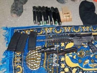 ضبط اسلحة وذخيرة في الرام واعتقال مشتبه