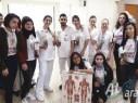 طلاب محمود درويش مجد الكروم يوزعون الهدايا على المرضى في مستشفى نهاريا