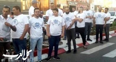 توزيع البرنامج الانتخابي للحراك الشّبابيّ في عرّابة