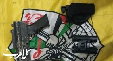 اعتقال مشتبه فلسطيني بعد ضبط سلاح وذخيرة