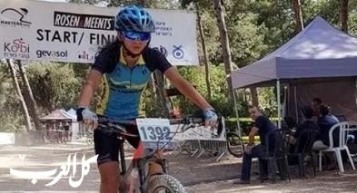 ليان طه من شعب بطلة سباق الدراجات الجبلية