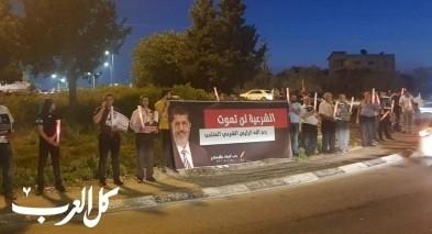 وقفة اضاءة شموع لروح الرئيس المصري بدوار الرينة