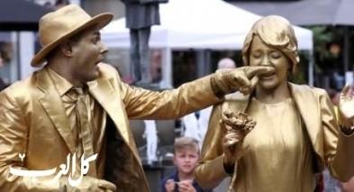 شاهدوا بالصور.. تماثيل حية تغزو شوارع بلجيكا