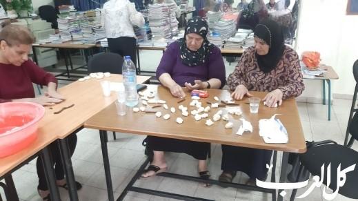 الناصرة: نساء حي الفاخورة يقمن بإعداد كعك العيد