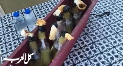 ضبط 8 زجاجات حارقة في منزل بمدينة عرابة