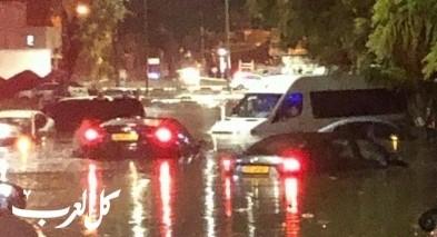 مياه الامطار تغرق شوارع اشكلون وانقاذ عالقين