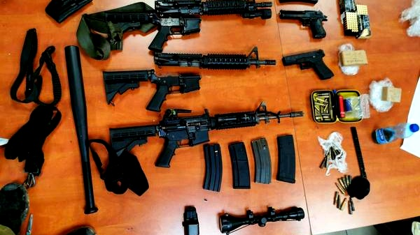 ضبط اسلحة وذخيرة وامشاط في الرام واعتقال مشتبه