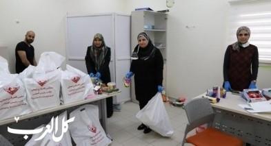 مجلس كفرقرع يوزع بطاقات شراء ورزم طبية