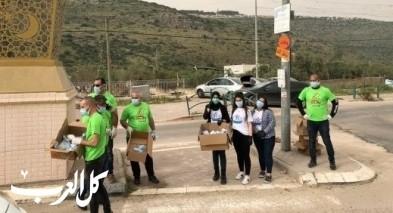 متطوعون يوزعون أكثر من ألفي كمامة وكفوف في شعب
