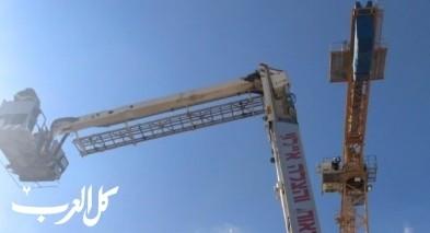 موديعين: إنقاذ عامل علق على رافعة