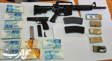 اللقية: ضبط مسدس وبندقية و300 الف شيكل