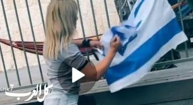 اعتقال فتاة مقدسية بشبهة تمزيق اعلام اسرائيلية