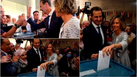 بشار الأسد يدلي بصوته في دوما برفقة زوجته