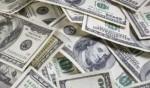 الدولار يتراجع ويتجه لتكبد رابع خسائره الأسبوعية